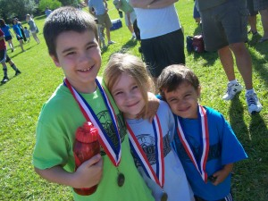 Showing off their medals on the last day of Spring Soccer.  They all had great seasons ~ Brianna even scored a goal!